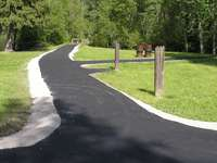 The existing asphalt on all trails was removed, graveled and re-graded. A trail paver was used.