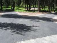 This shows  the two host sites at Seeley Lake Campground which were both grade engineered, graveled, paved and shouldered up. Notice the joint tie-in to our overlay on the main line of the road.